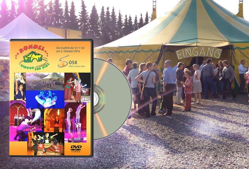"""Standbild aus Film: Zirkuszelt außen mit DVD Cover """"Rondel Circus for Kinds - Der Auftritt der U1 + U2 am 2. Oktober 2014 - Offene Schule Köln"""""""